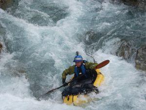 Photo of Shane (the author) packrafting, South Island, New Zealand; Alpacka Raft Calendar December 2014